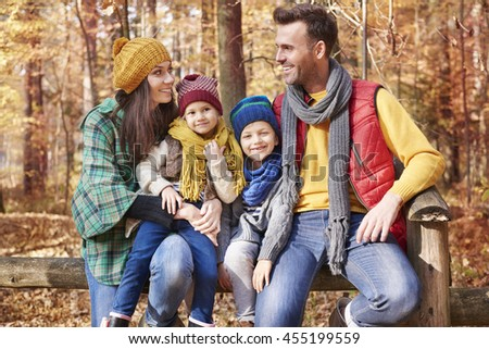Happy family during the autumn