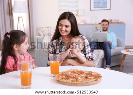 Happy family eating food on kitchen