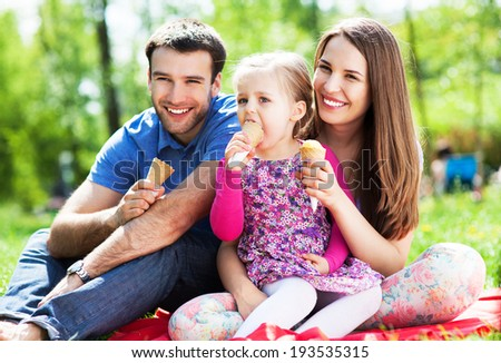 Happy family eating ice cream - stock photo