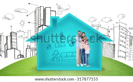 Happy family embracing each other over against house shape with living room sketch - stock photo