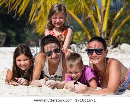 Happy family enjoy summer day at the beach - stock photo