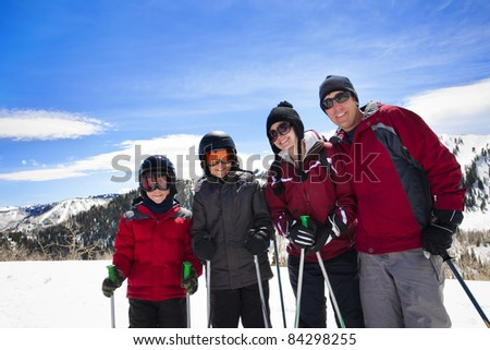 Happy Family Enjoying a day Skiing together - stock photo