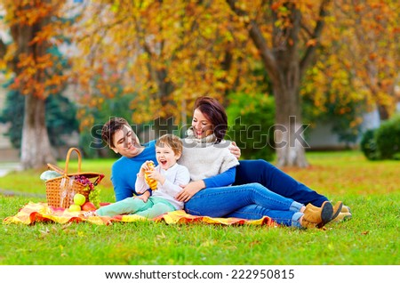 happy family enjoying autumn picnic - stock photo