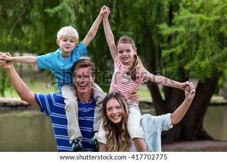 Happy family enjoying in the park on a sunny day - stock photo