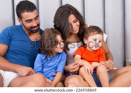 Happy family enjoying the morning in bed