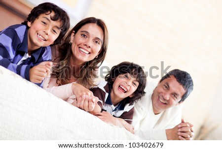 Happy family enjoying their time together at home - stock photo