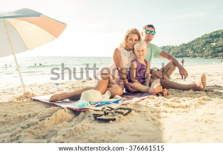Happy family enjoying time on the beach. concept about family and vacations - stock photo