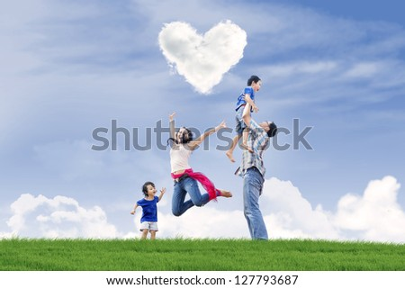 Happy family enjoying Valentine's day in the park