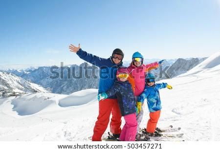 Happy family enjoying winter vacations mountains stock for Best family winter vacations