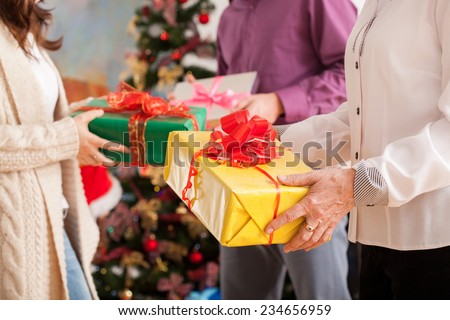 Happy family exchanging theirs Christmas gifts  - stock photo