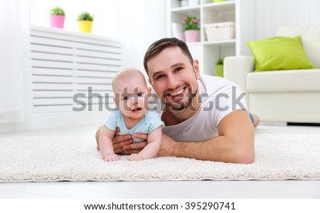 happy family father and baby son at home - stock photo