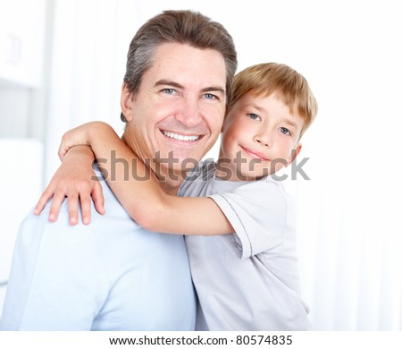 Happy family. Father  and son at home. - stock photo