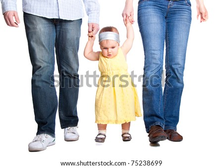 Happy family. Father, mother and baby's first steps - stock photo