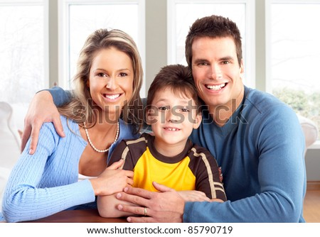 Happy family. Father, mother and boy at home. - stock photo