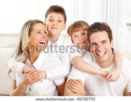 Happy family. Father, mother and children at home - stock photo