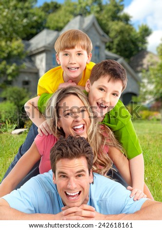 Happy family. Father, mother and children near new house - stock photo