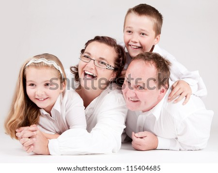 Happy family. Father, mother and children. Over white background.