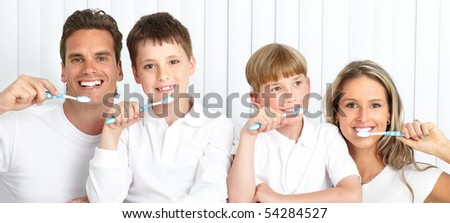 Happy family. Father, mother and children with toothbrushes. - stock photo