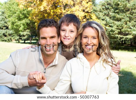 Happy family. Father, mother and son in the park