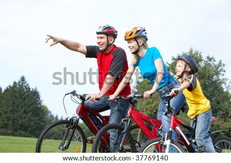 Happy family. Father, mother and son riding  in the park