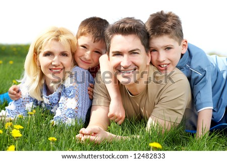 Happy family. Father, mother and sons in the park - stock photo