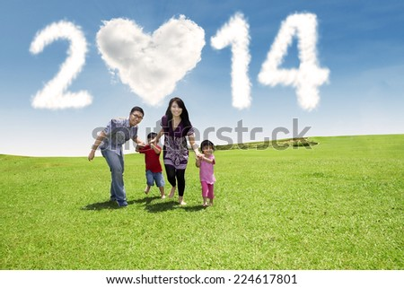 Happy family: Father, Mother, and their children. Shot outdoor in summer day - stock photo