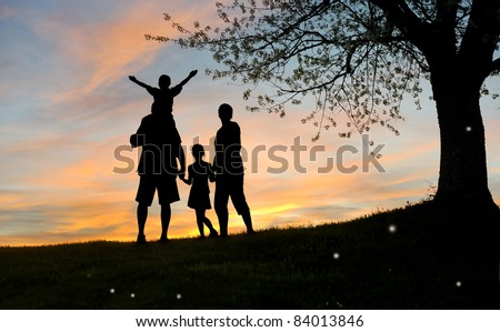 Happy family, father, mother, son and daughter in nature, sunset - stock photo