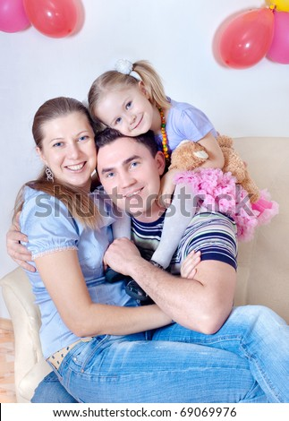 Happy family from three persons - stock photo