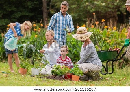 Happy family gardening on a sunny day