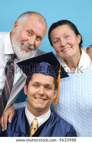 Happy family gathered together to celebrate grad day - stock photo