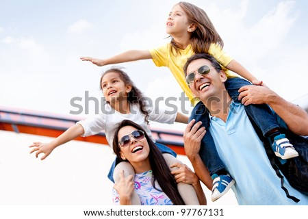 Happy family going on holidays and traveling by airplane - stock photo