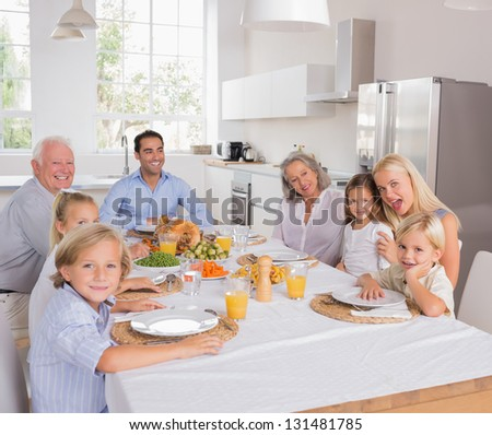 Happy family going to eat for thanksgiving - stock photo