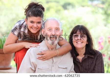 Happy  family grandad, mum and daughter, grandaughter, child grandpa, grandparent, parent,  or carers. - stock photo