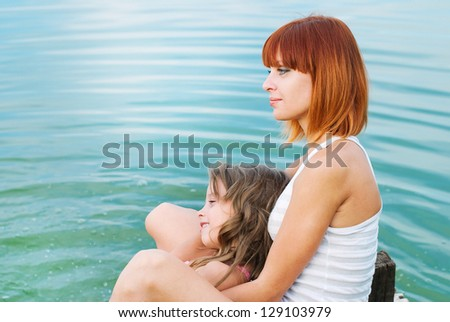 Happy family. Happy mother and daughter together outdoors. Conceptual idea - child care. Happy people - stock photo
