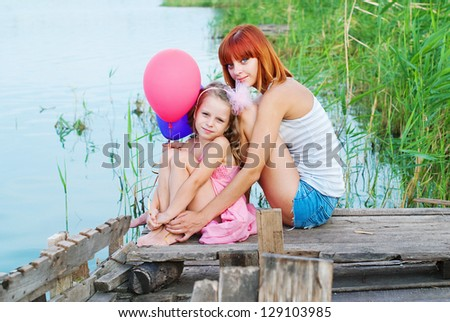 Happy family. Happy mother and daughter together outdoors. Conceptual idea - happy people - stock photo