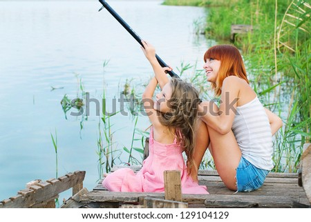 Happy family. Happy mother and daughter together outdoors. Family on fishing. Conceptual idea - happy people, activity - stock photo