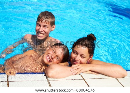 Happy family have relax in swimming pool - stock photo