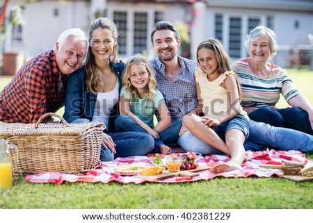 Happy family having a picnic in the garden - stock photo