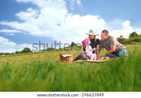 Happy family having a picnic in the park - stock photo