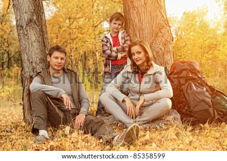 Happy family having a rest outdoor in tent. - stock photo