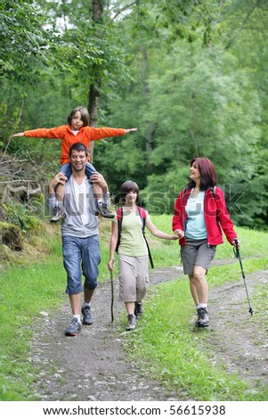 Happy family having a walk in the countryside - stock photo
