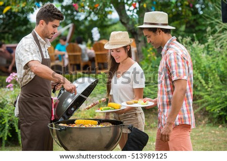 Happy family having barbecue on sunny day, Garden