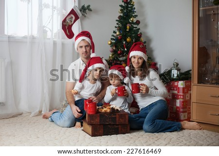 Happy family having breakfast on Christmas - stock photo