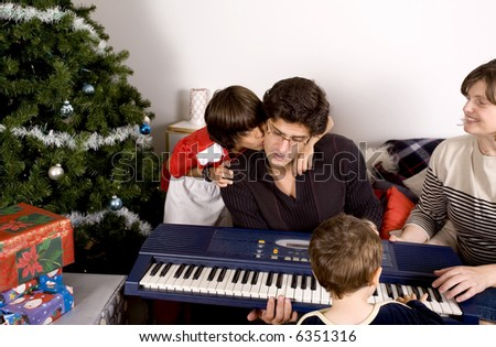 happy family having fun and opening gift at christmas time - stock photo