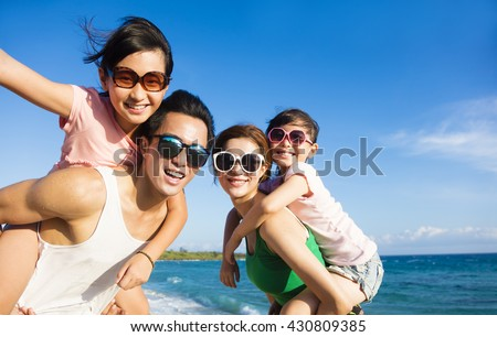 Happy Family Having Fun at the Beach - stock photo