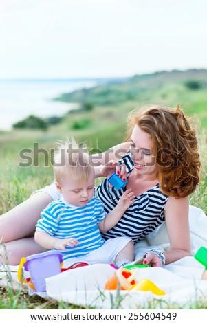 Happy family having fun at the beach in summer  - stock photo