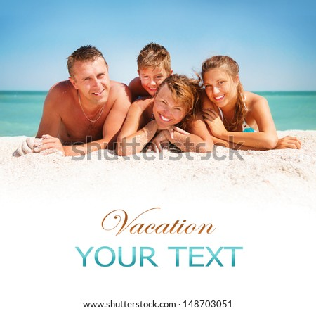 Happy Family Having Fun at the Beach. Joyful Family. Vacation and Travel concept. Summer Holidays. Parents with Children enjoying a holiday at the sea - stock photo