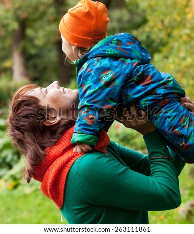 Happy family having fun in autumn park. Mother and little girl. - stock photo