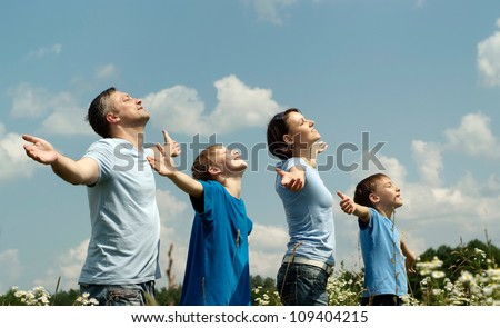 Happy family having fun in the company of each other on the nature - stock photo