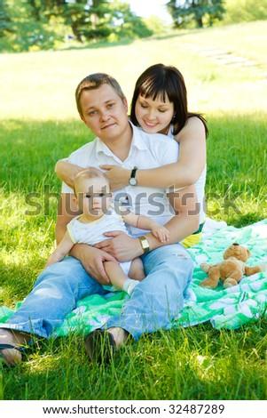 Happy family having fun  in the park - stock photo